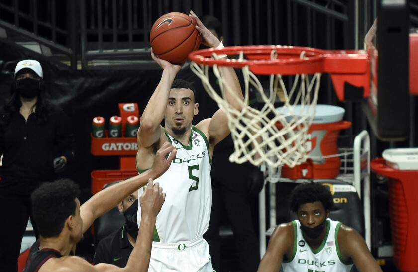 Oregon guard Chris Duarte (5) shoots a three-pointer during second half of an NCAA college basketball game Saturday, Jan. 2, 2021 in Eugene, Ore. Duarte had 23 points in Oregon's 73-56 win. (AP Photo/Andy Nelson)