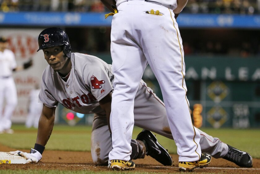 Boston Red Sox's Jemile Weeks gets up after being called out for being hit by a ground ball down the third baseline by Boston's Will Middlebrooks during the ninth inning of a baseball game against the Pittsburgh Pirates in Pittsburgh Thursday, Sept. 18, 2014. The Pirates won 3-2. (AP Photo/Gene J.