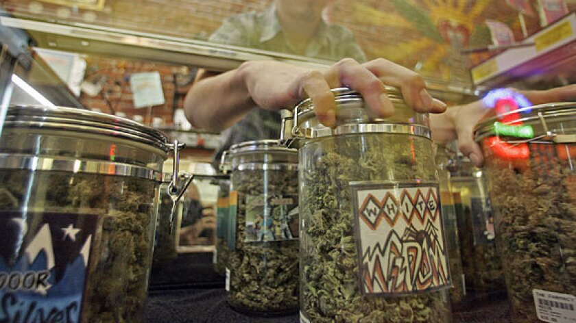 A clerk handles the merchandise at a Southern California marijuana dispensary.