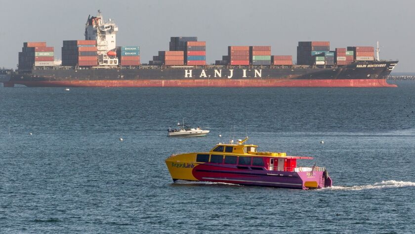 South Korea's Hanjin Shipping Co. container ship Hanjin Montevideo, top, is anchored outside the Port of Long Beach on Sept. 1.