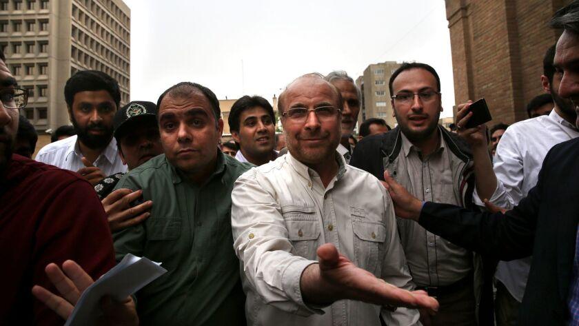 Tehran's mayor Mohammad Bagher Qalibaf, center.