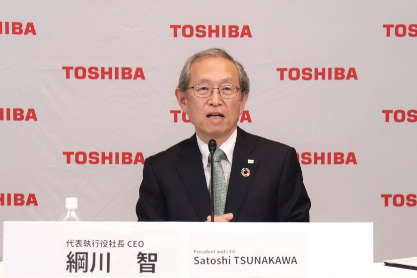 In this image provided by Toshiba Corporation, new Toshiba President Satoshi Tsunakawa speaks during an online press conference in Tokyo, Wednesday, April 14, 2021. Nobuaki Kurumatani, the president of Toshiba Corp. stepped down Wednesday, a week after the Japanese technology and manufacturing giant said it was studying an acquisition proposal from a global fund where he previously worked. Kurumatani will be replaced by his predecessor, Tsunakawa. (Toshiba Corporation via AP)