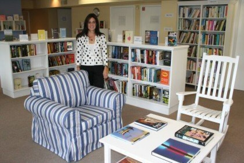 Rancho Santa Fe Library Guild member Sara Levy Buehner helped give The Book Cellar a new look in its new location. Photo/Karen Billing