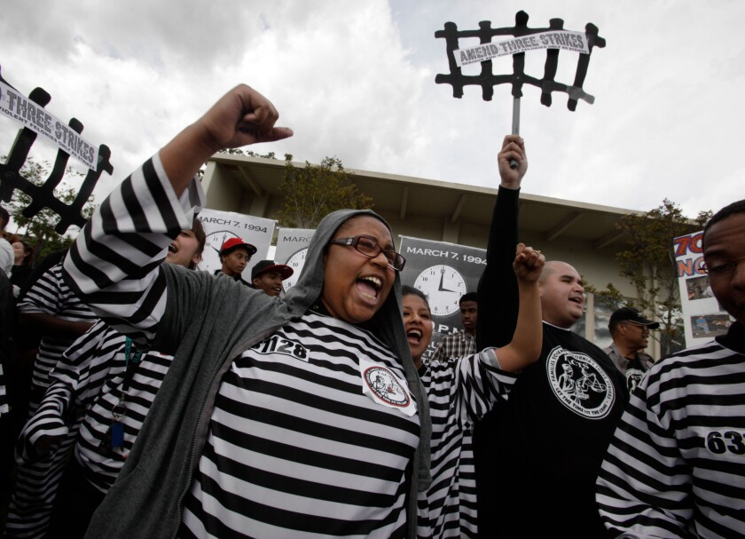"""Jade Salery of Youth Justice Coalition plays the role of a prisoner during a mock trial In Hollywood staged by the citizens coalition Families to Amend California's Three Strikes to protest the """"high cost of implementing the three strikes law"""" on the 17th anniversary of it being signed into law."""