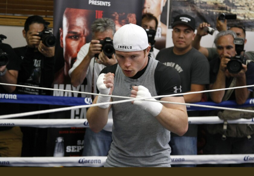 "Saul ""Canelo"" Alvarez goes through a workout at a media event on Aug. 28, 2013, in Big Bear, Calif."
