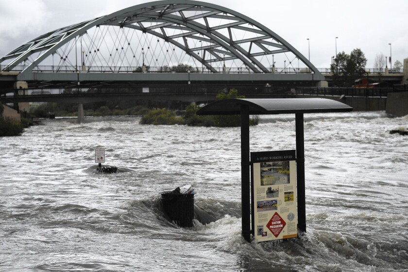 """Heavy rain floods a path at Confluence Park in Denver. The heavy rains are being called a """"May miracle."""""""