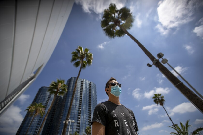Brandon Leslie, a nurse at Good Samaritan Medical Center in Los Angeles, wears a face mask in downtown L.A. on June 18