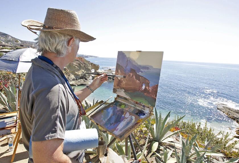 Artist Bill Davidson paints the arch and coves where he participates in Laguna Beach's Plein Air Inv
