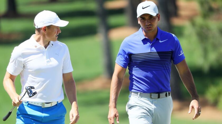 AUGUSTA, GA - APRIL 04: Jason Day of Australia and Scott Gregory of England walk together on the se