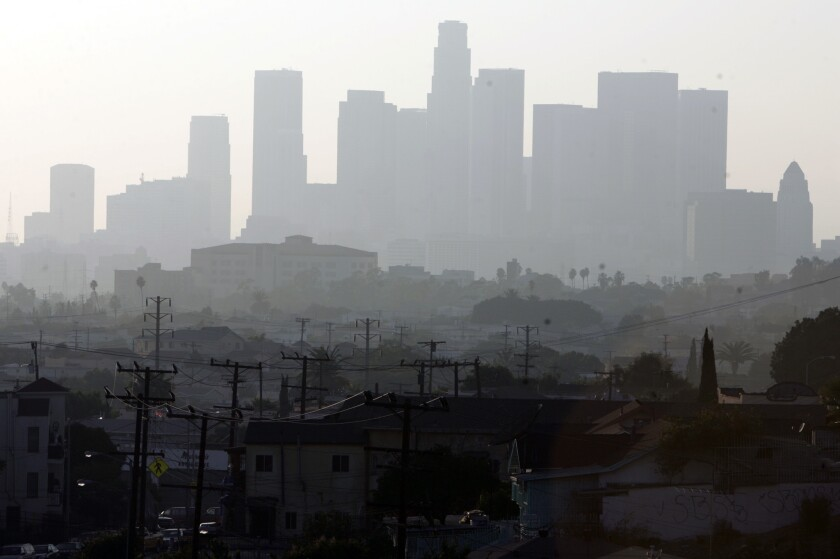 Smog could get worse by mid-century as climate change boosts summer temperatures and accelerates the formation of ozone, a new study says. Above, a hazy day in Los Angeles.