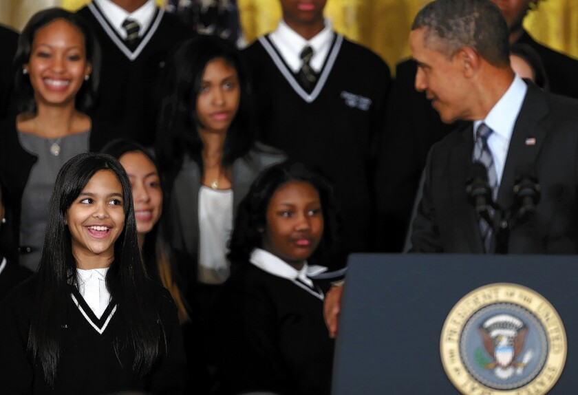 President Obama with students at a New York City school on Thursday as he identifies 'Promise Zones' in five cities that will be eligible for federal anti-poverty grants.