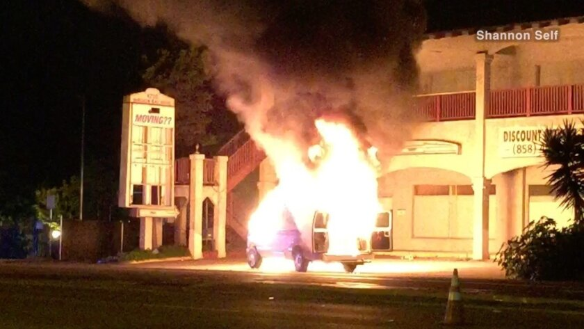 The AMR ambulance caught fire in Pacific Beach shortly before 2 a.m. Everyone got out safely.