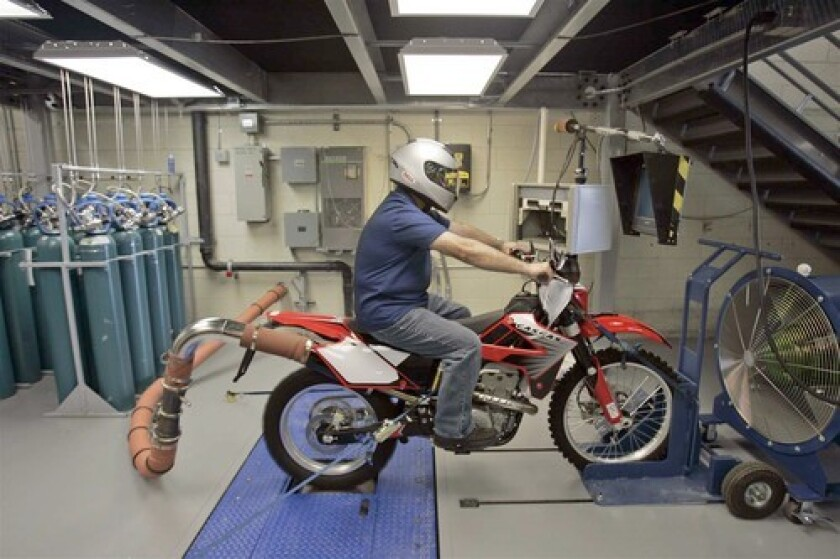 Tom Santos, 56, uses a Dynamometer to simulate the emission test of a Gas Gas FSR 450 motorcycle at California Air Resources Board facility in El Monte.
