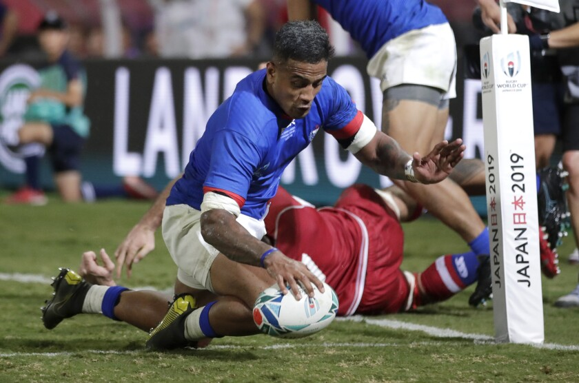 Samoa's Rey Lee-lo, centre scores a try during the Rugby World Cup Pool A game between Russia and Samoa at Kumagaya Rugby Stadium, Kumagaya City, Japan, Tuesday, Sept. 24, 2019. (AP Photo/Jae Hong)