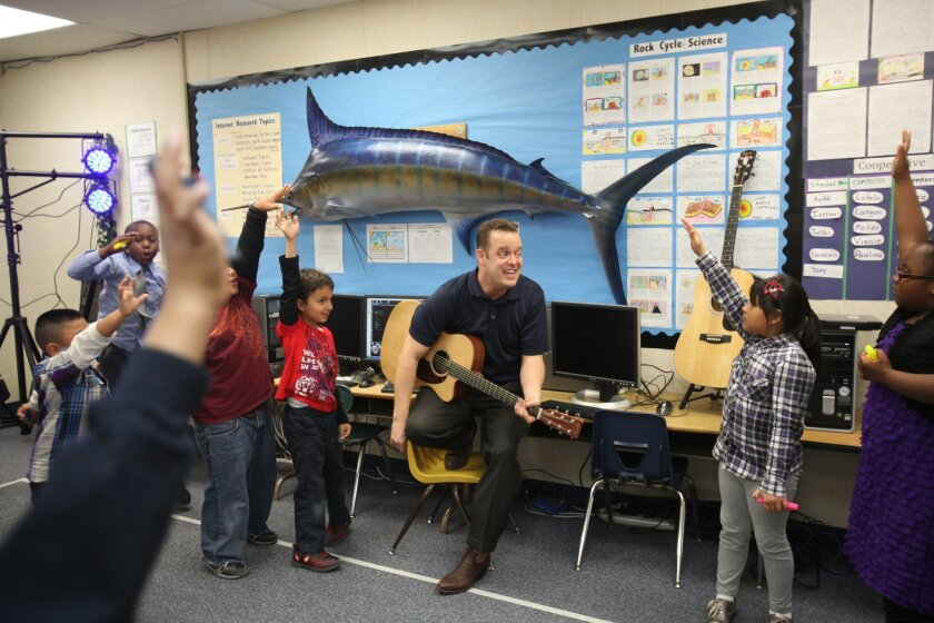 Garrison Elementary School teacher Jon Schwartz sings blues and other songs with students as a way of teaching subjects like American history and geography. They are scheduled to perform at a corporate function in Del Mar this month.