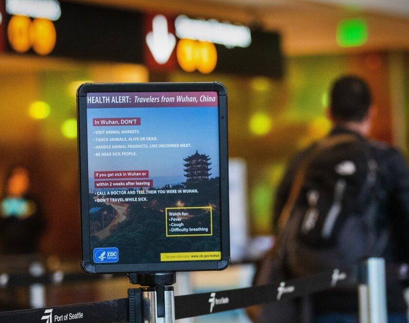 Coronavirus sign at SeaTac airport
