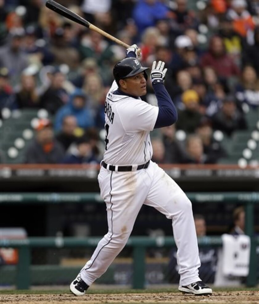 Detroit Tigers' Miguel Cabrera watches his three-run home run against the Toronto Blue Jays in the fourth inning of a baseball game in Detroit, Tuesday April 9, 2013. (AP Photo/Paul Sancya)