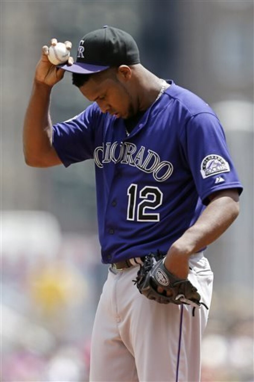 Colorado Rockies starting pitcher Juan Nicasio (12) stands on the mound during the first inning of a baseball game against the Pittsburgh Pirates in Pittsburgh, Sunday, Aug. 4, 2013. The Pirates won 5-1. (AP Photo/Gene J. Puskar)