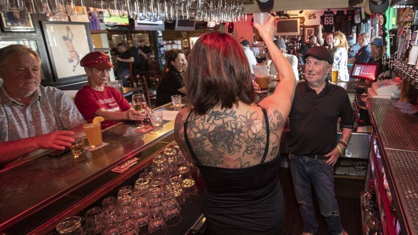 Gary Monahan and his long time manager Chanda Heinz hoist an Irish rootbeer in a toast to on Monday,
