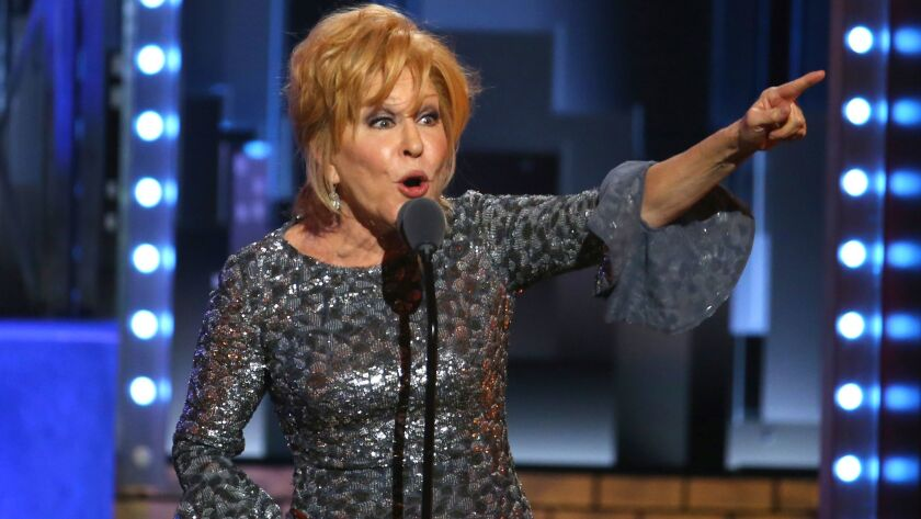 Bette Midler accepts the award for best performance by an actress in a leading role in a musical for