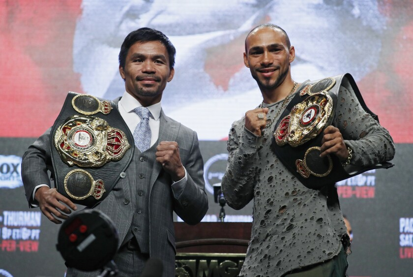 Manny Pacquiao, left, and Keith Thurman pose during a news conference in Las Vegas on Wednesday.