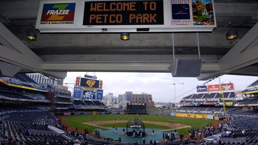 The first fans pour into PETCO Park for the first game at the new home of the San Diego Padres, Thur