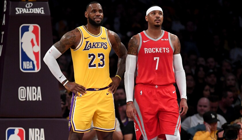 Lakers forward LeBron James and Rockets forward Carmelo Anthony chat during a break in play on Oct. 20, 2018, at Staples Center.