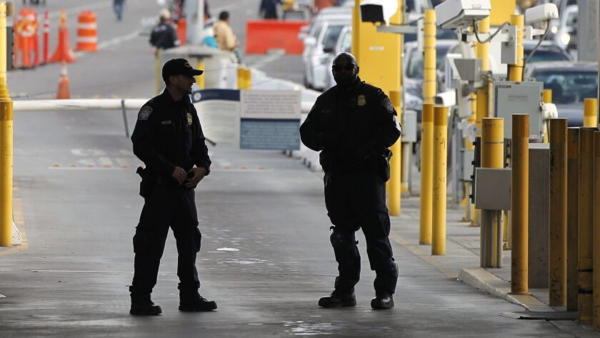 SAN YSIDRO , February 10, 2017 | Two U.S. officers stand at the checkpoint for cars at the San Ysidr