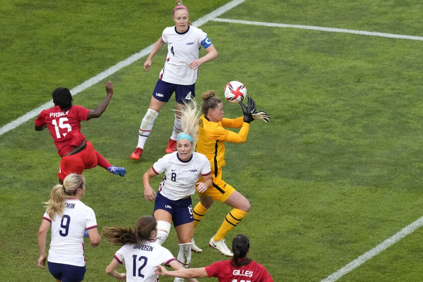 United States' goalkeeper Alyssa Naeher, right, catches a ball during a women's semifinal soccer match against Canada at the 2020 Summer Olympics, Monday, Aug. 2, 2021, in Kashima, Japan. (AP Photo/Martin Mejia)