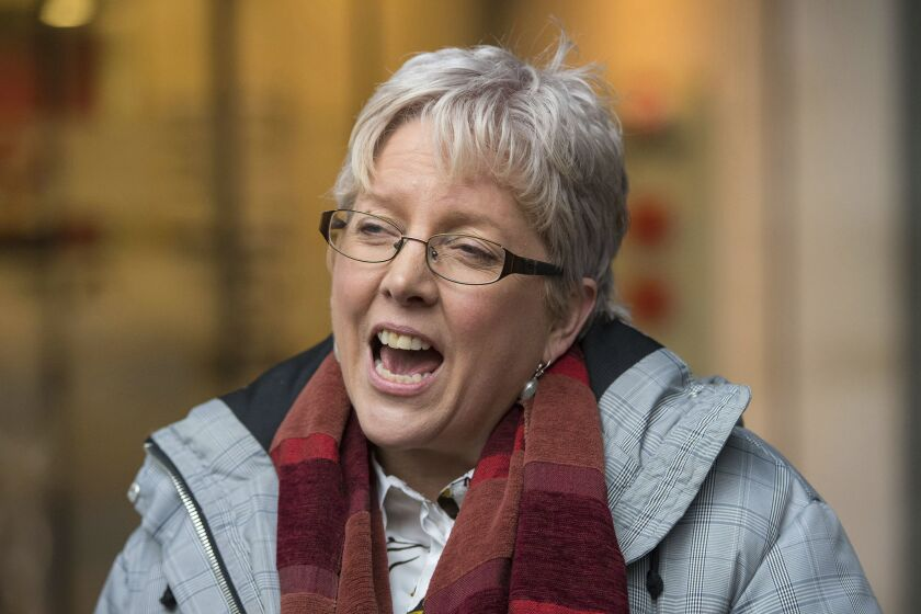 BBC's China editor Carrie Gracie speaks to the media outside BBC Broadcasting House in London, Monday Jan. 8, 2018. The BBC's China editor has resigned her position in Beijing in protest over what she called a failure to sufficiently address a gap in compensation between men and women at the public broadcaster.