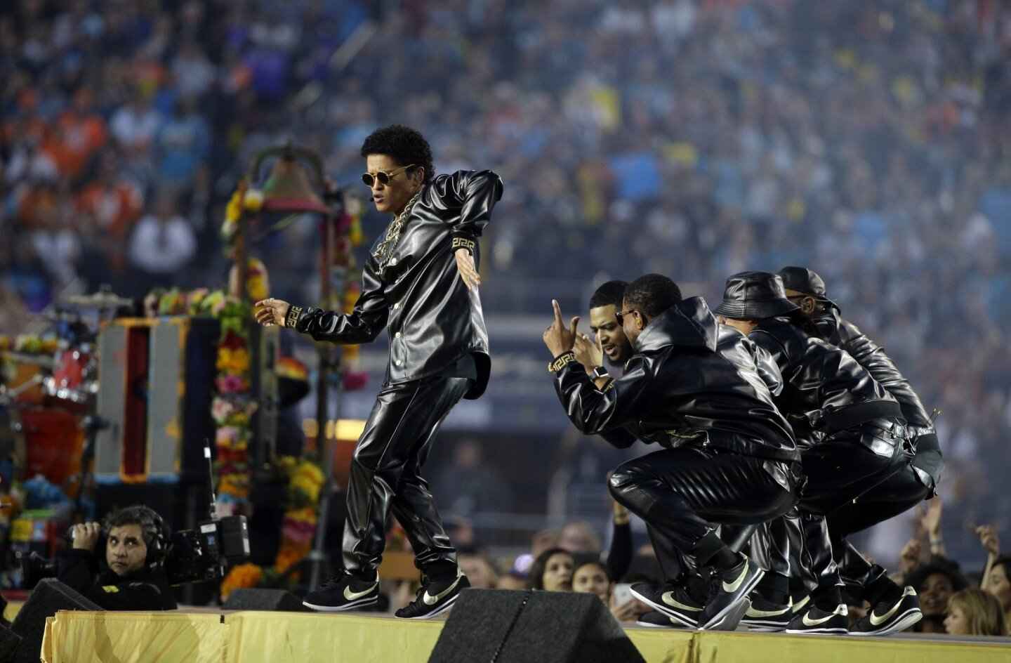 Bruno Mars, far left, performs during halftime of the NFL Super Bowl 50 football game Sunday, Feb. 7, 2016, in Santa Clara, Calif. (AP Photo/Julie Jacobson)