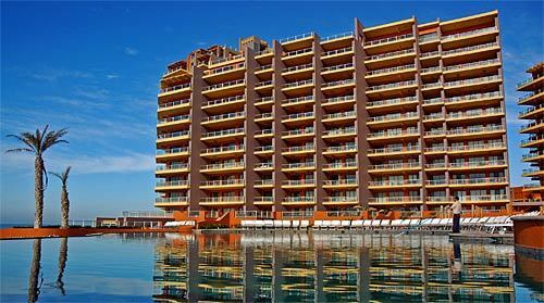 Puerto Peñasco, on the northeast coast of Mexico's Gulf of California, is committed to raising its profile, and raising up condominium towers -- such as this one, at Las Palomas development -- and vacation homes are one way to do it. Las Palomas is among several condo resorts (it also rents units to guests) that have risen in the last five years as Puerto Peñasco, in Sonora state, seeks to lure visitors away from nearby Baja California.