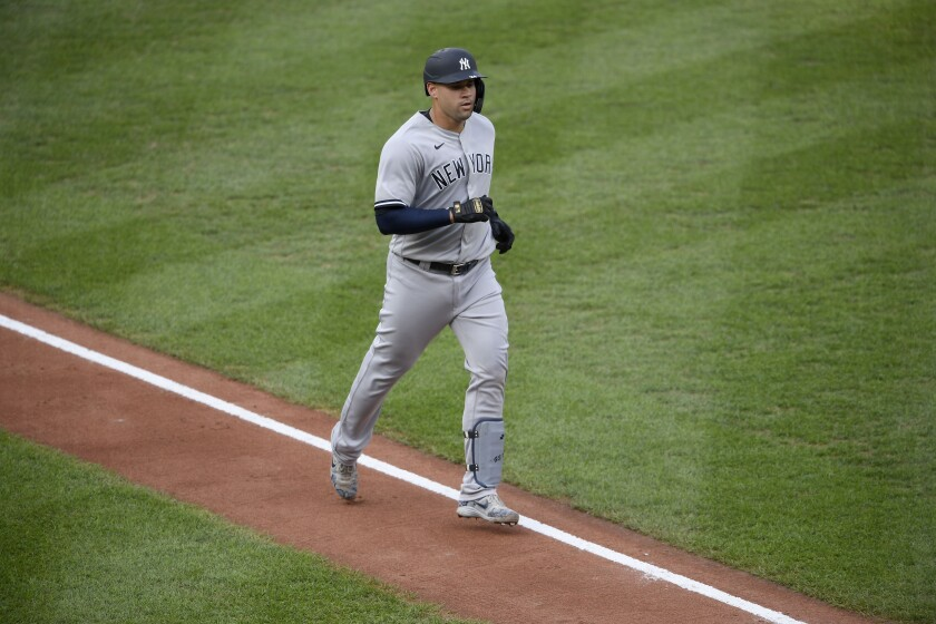 New York Yankees' Gary Sanchez trots toward home after he hit a home run during the second inning of the first baseball game of a doubleheader against the Baltimore Orioles, Friday, Sept. 4, 2020, in Baltimore. (AP Photo/Nick Wass)