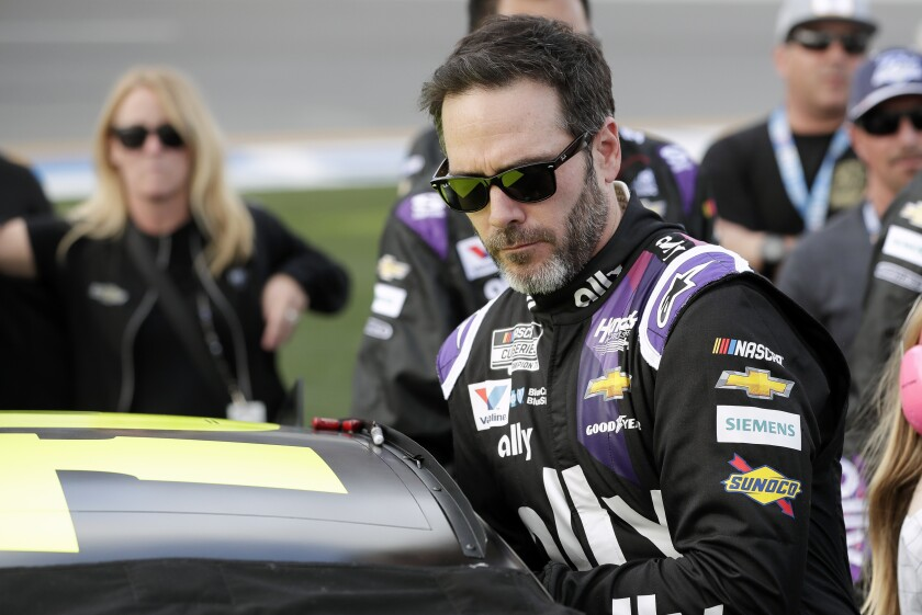 In this Feb. 16, 2020, photo, Jimmie Johnson climbs into his car before the Daytona 500.