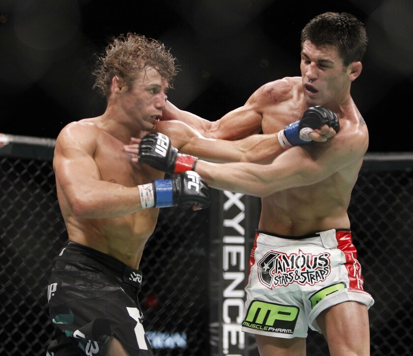 FILE- In this July 2, 2011, file photo, Urijah Faber, left, trades punches with Dominick Cruz during the first round of their UFC bantamweight mixed martial arts title match at The MGM Grand Garden Arena in Las Vegas. Dominick Cruz has hated Urijah Faber for years, and Luke Rockhold has a deep disl