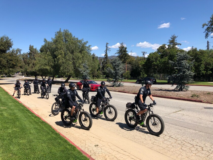 Los Angeles closed Griffith Park's trail network on Wednesday, but many hikers, walkers and cyclists remained on roads and grass Thursday, including these LAPD officers on patrol.