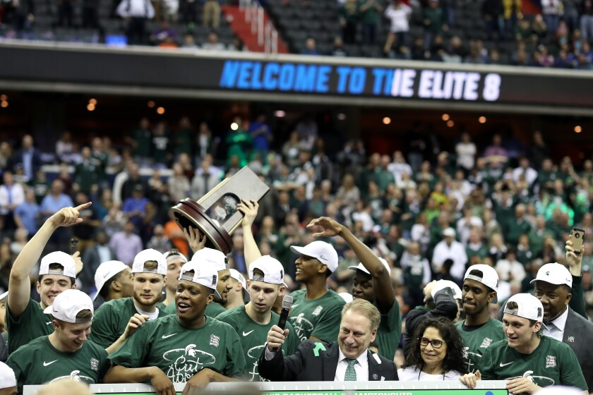 Michigan State after winning a 2019 NCAA men's basketball tournament game.
