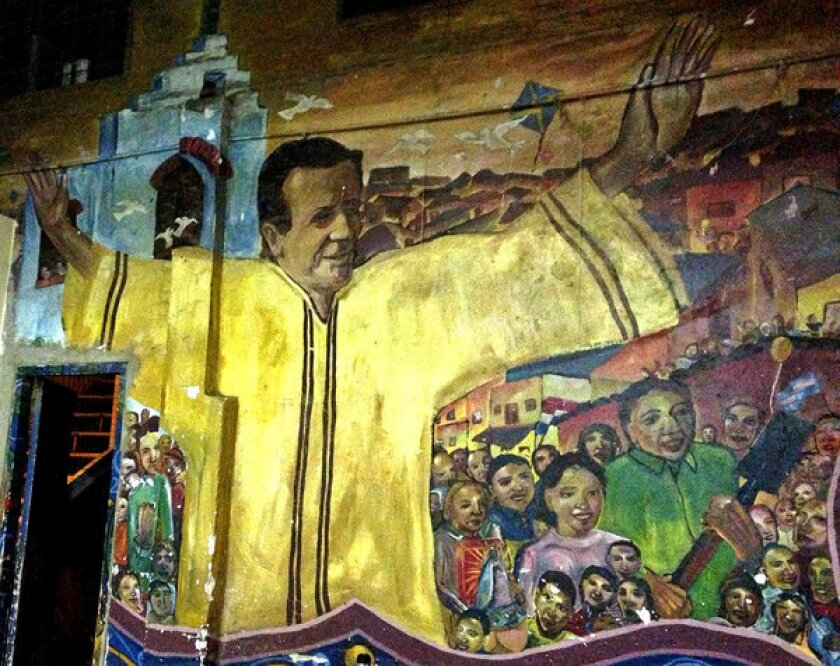 """A mural in one of Buenos Aires' shantytowns, where """"slum priests"""" have worked for decades, combating poverty, drug addiction and homelessness. The priests now have the support from the highest ranks of the Catholic Church. Jorge Mario Bergoglio, who served as archbishop of Buenos Aires for 15 years before taking the title of Pope Francis earlier this year, made the slum priests a priority. He tripled their numbers, opened new chapels and visited frequently, usually arriving on his own by city bus."""