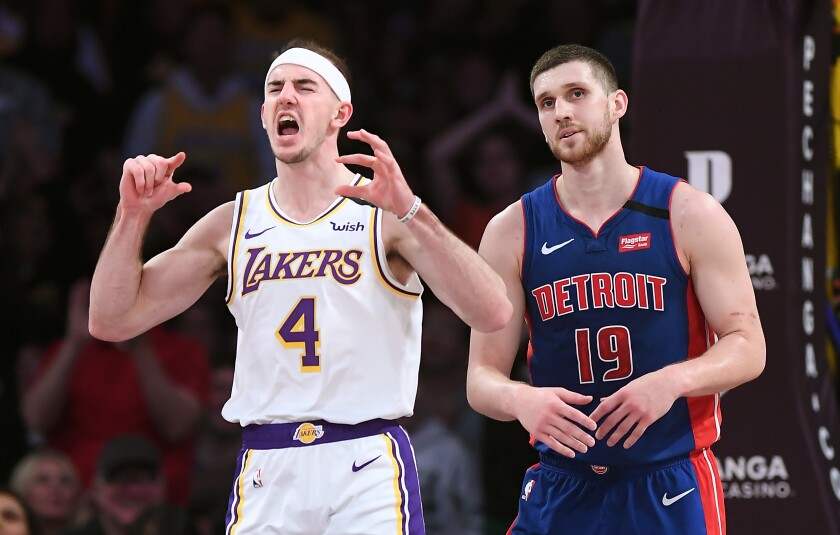 Alex Caruso celebrates a dunk against the Detroit Pistons on Sunday.