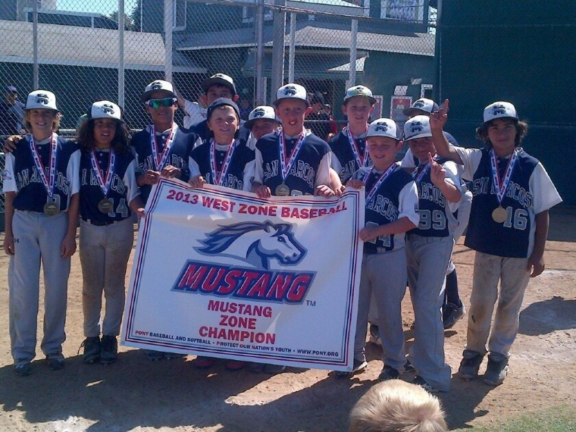 Members of the Pony All-Stars Mustang San Marcos XTreme boys baseball team celebrate their victory July 28 as West Zone champions. CREDIT: Charlotte Souza