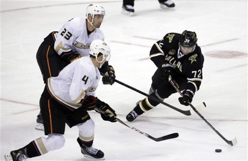 Anaheim Ducks defenseman Cam Fowler (4) and Francois Beauchemin (23) defend against an offensive push by Dallas Stars right wing Erik Cole (72) in the third period of an NHL hockey game, Thursday, March 14, 2013, in Dallas. The Ducks won 2-1 in a shootout. (AP Photo/Tony Gutierrez)