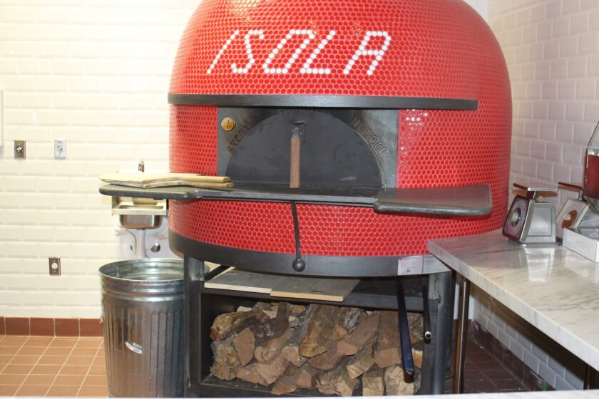 The wood-burning oven at Isola pizza bar will cook pizzas and other speciality dishes, when it opens later this month.