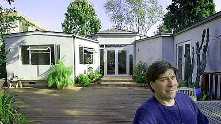 """WAITING IT OUT: Eric Broida is interested in buying a nearby house, but doesn't plan on doing so until the asking price drops another $400,000. The price has already been cut several times by the sellers, from the original $4.6 million to $3.6 million. Broida, above, at his Pacific Palisades home. """"People tell me I'm crazy [to think prices will keep falling], but that's what they told me in 1992,"""" he says."""