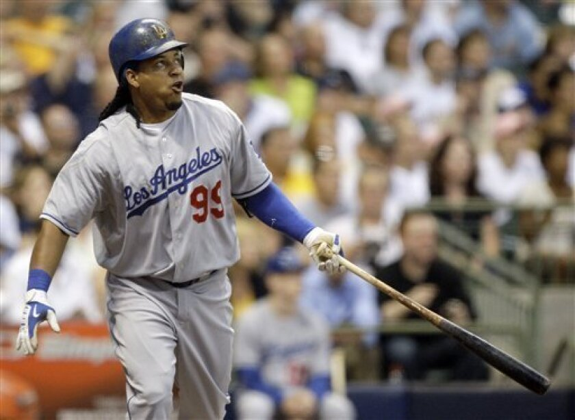 Los Angeles Dodgers' Manny Ramirez reacts after hitting a two-run home run during the sixth inning of a baseball game against the Milwaukee Brewers Friday, July 10, 2009, in Milwaukee. (AP Photo/Morry Gash)