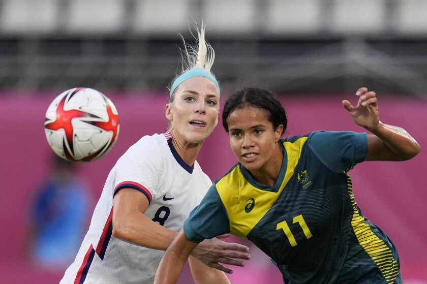 The USWNT's Julie Ertz and Australia's Mary Fowler chase the ball.