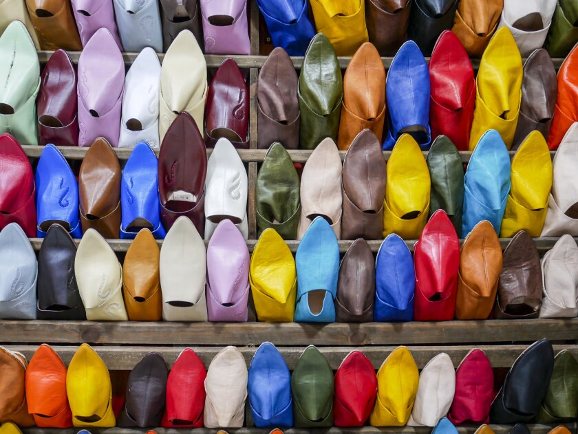 FEZ, MOROCCO - A stall specializes in selling colorful slippers called babouches in the ancient wall
