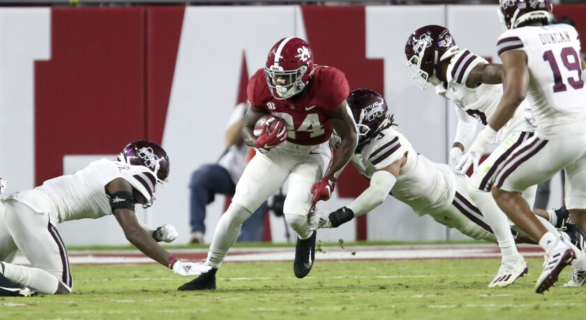 Mississippi State tacklers surround and bring down Alabama running back Trey Sanders (24) during an NCAA college football game Saturday, Oct. 31, 2020, in Tuscaloosa, Ala. (Gary Cosby Jr./The Tuscaloosa News via AP)