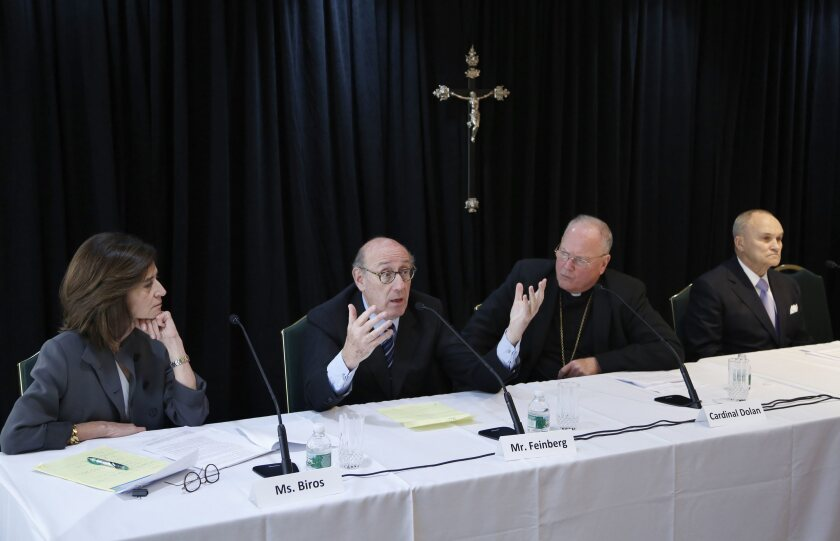 In October 2016, Kenneth Feinberg, second from left, speaks alongside Camille Biros, left, Cardinal Timothy Dolan, Archbishop of New York, second from right, and former New York City Police Commissioner Raymond Kelly at a news conference in New York announcing a new program intended to provide reconciliation and compensation for victims of sexual abuse by clergy. This week, six of California's dioceses, including San Diego, announced a program to compensate victims.