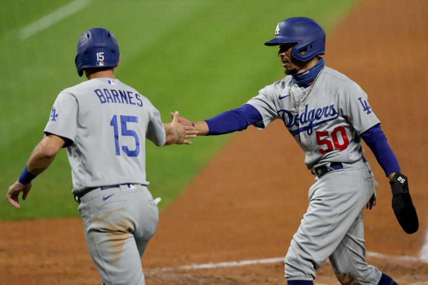 Dodgers catcher Austin Barnes, left, and right fielder Mookie Betts celebrate.