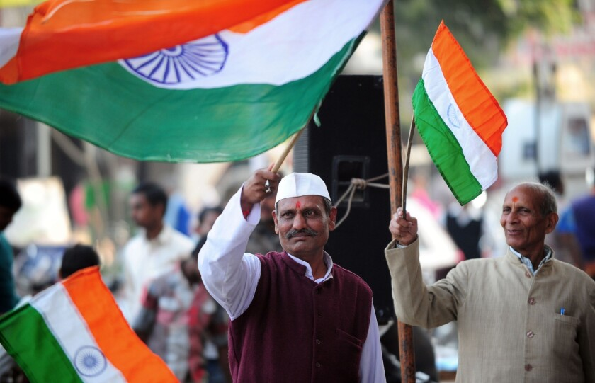 Supporters of Indian activist Anna Hazare celebrate in Allahabad after Parliament passed an anti-corruption measure.